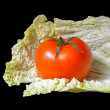 Stock Photo: Tomato and cabbage on black background