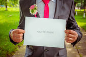 Groom with a sign. Wedding background — Stock Photo