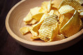 Chips in wooden dish — Stock Photo
