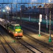 Train arriving at station in late evening — Stock Photo