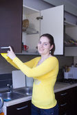 Attractive girl cleaning on the kitchen — Stock Photo