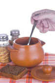 Pot with prepared meal and bread — Stock Photo