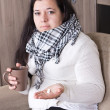 Stock Photo: Young womwith cold at home