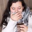 Young woman with cold and heavy cough at home — Stock Photo