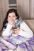Young woman with cold at home — Stock Photo