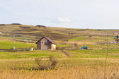 Small house on a hill — Stockfoto