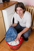 Young man doing laundry at home — Stock Photo