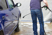 Man washing his car at self-service station — Stock Photo