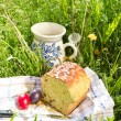 Easter panettone, eggs and jug with compote — Stock Photo #45168349