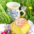 Easter panettone, eggs and jug with compote — Stock Photo #45168373