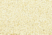 Porridge oats or oatmeal background — Foto Stock