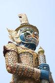 Large giant statue holding a baton — Stock Photo