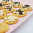 Stock Photo: Sweet crackers on pink plate