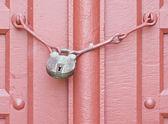 Antique door key with red door — Stok fotoğraf