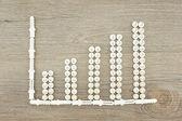 Tornillos y tacos colocados como gráfico de barras — Foto de Stock