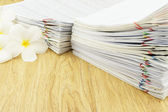 Document sales receipt with plumeria — Stock Photo