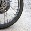 Old black wheel of motorcycle and disc brake — Stock Photo #46165819