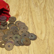 Old ancient coins of Thailand with red bag — Stock Photo