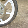Old black magnesium alloy wheel of motorcycle and disc brake — Stock Photo #49098153