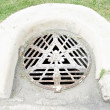 Drain cap at urban street — Stock Photo #50377657