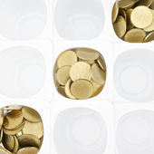 Gold coin in white cup — Stock Photo