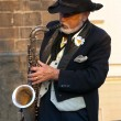 The street musician with a saxophone — Stock Photo