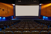 Hall of a cinema and lines of blue armchairs — Stock Photo