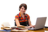 Yong student woman whit laptop and headset — Stock Photo