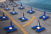 Empty beach with the closed umbrellas — Stock Photo