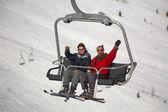 Mountain skiers on pendant road — Stockfoto