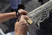 Hands spin a fishing net — Stock Photo