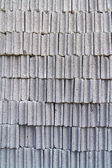 Gray concrete construction block wall — Stockfoto