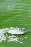 Rice in spoon on banana leaf — Stock Photo