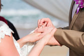 Hand putting a wedding ring — Stock Photo