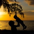 Mother and little son silhouettes — Stock Photo #38301691