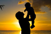 Mother and little son silhouettes — Stock Photo