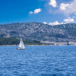 Stock Photo: Sailing boat in blue sea