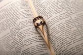 Wedding ring on a bible page — Stock Photo