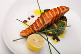 Grilled Fish Fillet with Vegetables on plate — Stock Photo