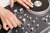 Dj mixer with hands making music — Stock Photo