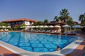 Swimming pool beauty — Stock Photo