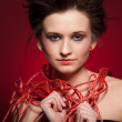 Youg woman with red web — Stock Photo