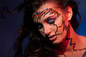 Girl with color face art — Stock Photo