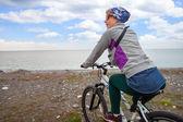 Cyclist woman — Stok fotoğraf