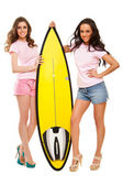 Young women  posing with a surfboard — Stock Photo