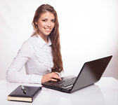 Businesswoman with notebook — Stock Photo