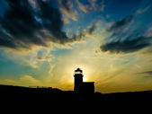 Sunset behind the lighthouse — Stock Photo