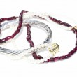 Necklaces, bracelet, diamonds and watch — Stock Photo