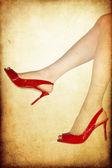 Perfect female legs wearing high heels — Stock Photo