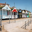 A row of brightly coloured beach huts in Southwold Suffolk — Stock Photo